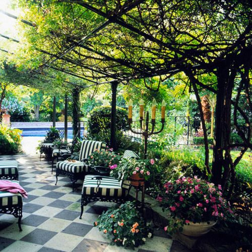 Fantastic outdoor space - overhead vine, rose & peach flowers, black & white, candelabra ...