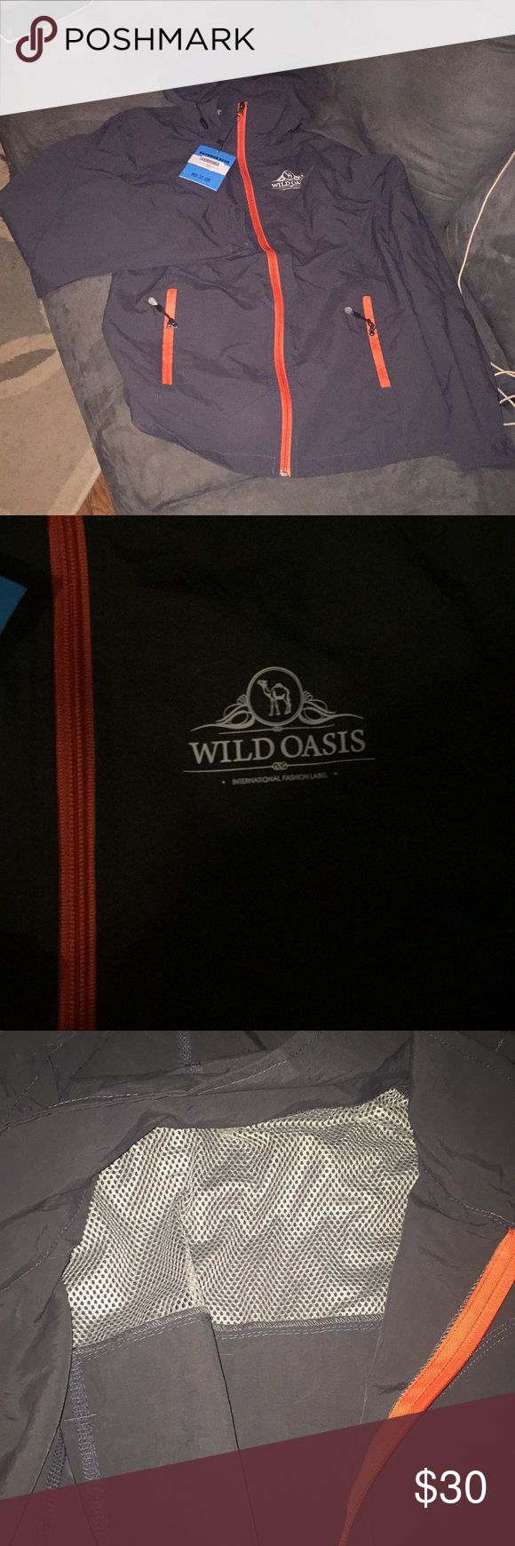 Lightweight jacket Dark gray with orange accents. Lightweight with a vent in the back. Great jacket for runners and golfers! Wild Oasis Jackets & Coats