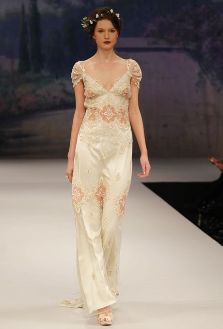 "Brides: Claire Pettibone - Fall 2012. ""Genevieve"" silk sheath wedding dress with pink and gold lace applique details, a v-neckline, and sheer cap sleeves, Claire Pettibone"