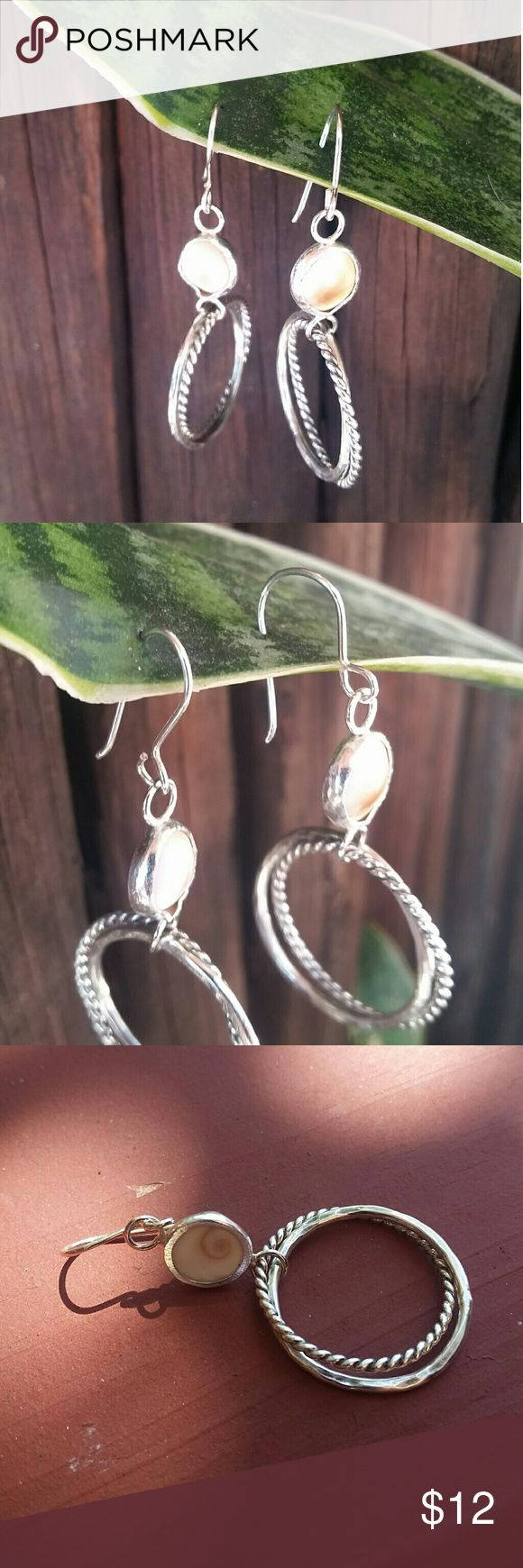 NEW LISTING Silver Earrings Double hoops, one hammered, one braided set off with a cowrie shell accent. Presumed SS but no stamp. Price reflects such. Jewelry Earrings