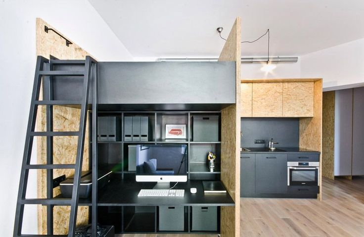 A work station nestled underneath a lofted bed