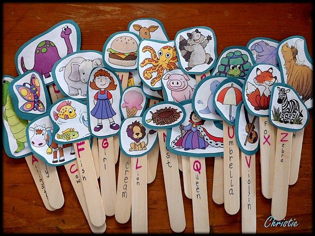 Alphabet puppets made from reusing your children's workbooks....so simple and engaging. Add both upper and lower case letters on the paddle pop sticks.