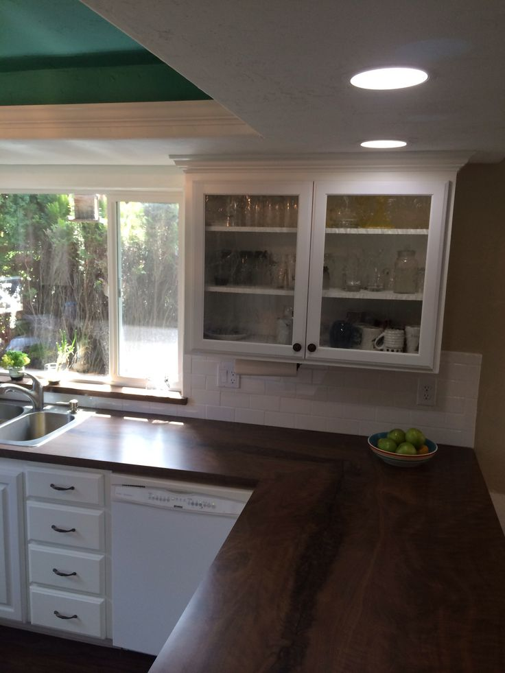Kitchen With White Cabinets White Subway Tile And