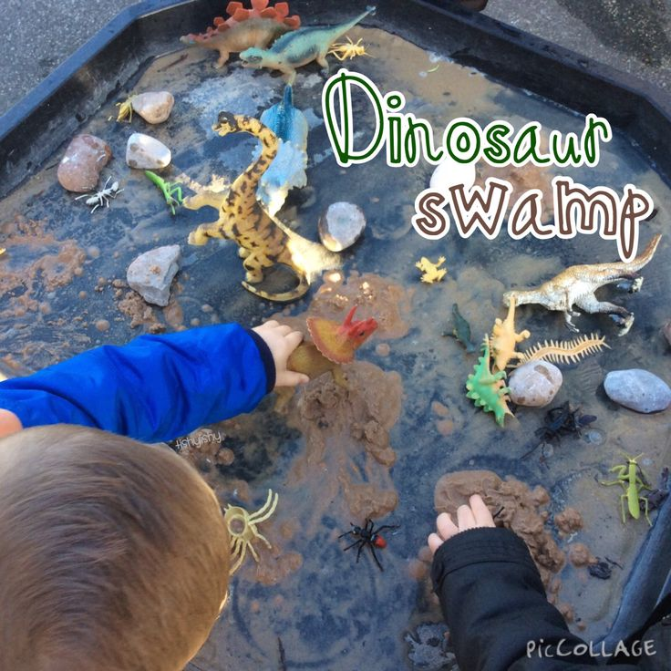 Simple small world. Tuff spot, dinosaurs, sand, stones and water = dinosaur swamp