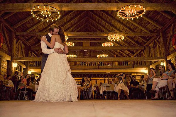 bride and groom dancing in barn