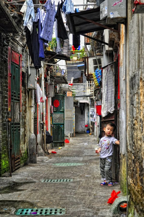 Do I Know You? by Derek Galon on 500px When on a business trip in Shenzhen, China, I stumbled upon a tiny old alley squeezed between high skyscrapers. Life seemed to go there on a different time, like clock stopped decades ago. As poor as this neighbourhood was, people of this old town seemed warm, patient and kind. Tiny streets were welcoming, and offered a glimpse at another world...