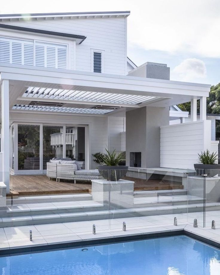 White exterior, outdoor fire, glass pool fence from @wholovesthat