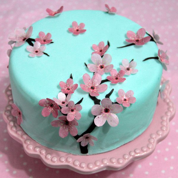These gorgeous edible cherry blossom flowers can be used on cookies, cake pops, cakes, cupcakes and other baking. You can use the flowers flat or 3-D, poised on