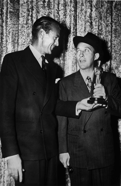 """Gary Cooper presents Bing Crosby with the Academy Award for Best Actor for """"Going My Way"""" 1944"""