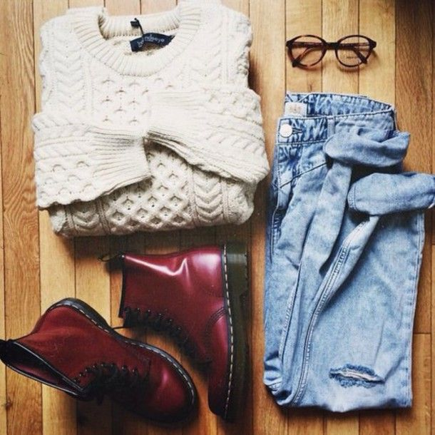11. Cream cable knit sweater, blue jeans, crimson Doc Martens, and clear lens glasses