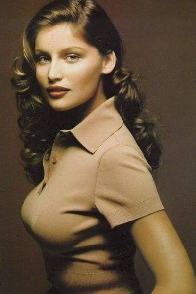 Laetitia Casta with a vintage 40s side swept curls | light brown hair | retro | 90s model