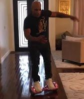 Mike Tyson Falls Off His Daughter's Hoverboard - Watch Video http://www.1starcutie.com/2015/12/video-of-mike-tyson-taking-hard-fall.html