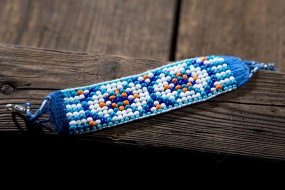Owls eyes. Beaded braceled. White, blue and orange beads. Cotton thread, clasp…