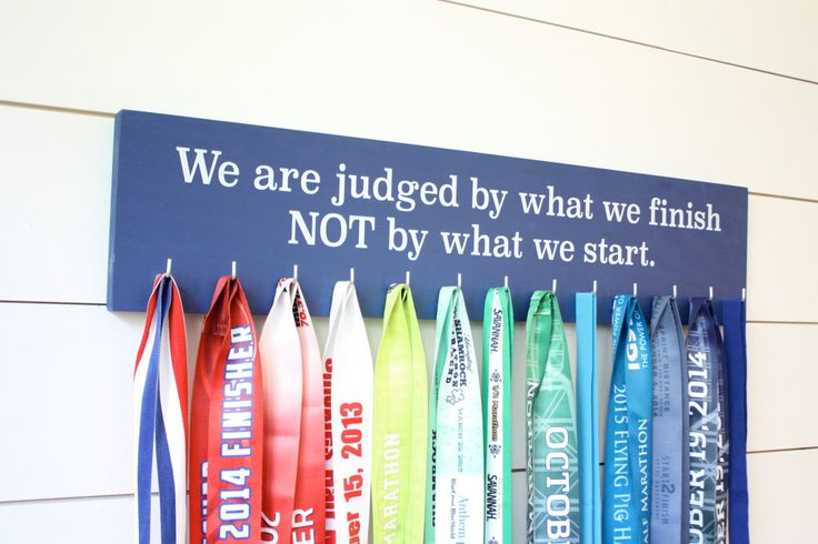 Medal Display - We are judged by what we finish NOT by what we start. - Large - Running / Triathlon / Ultra / Obstacle Race