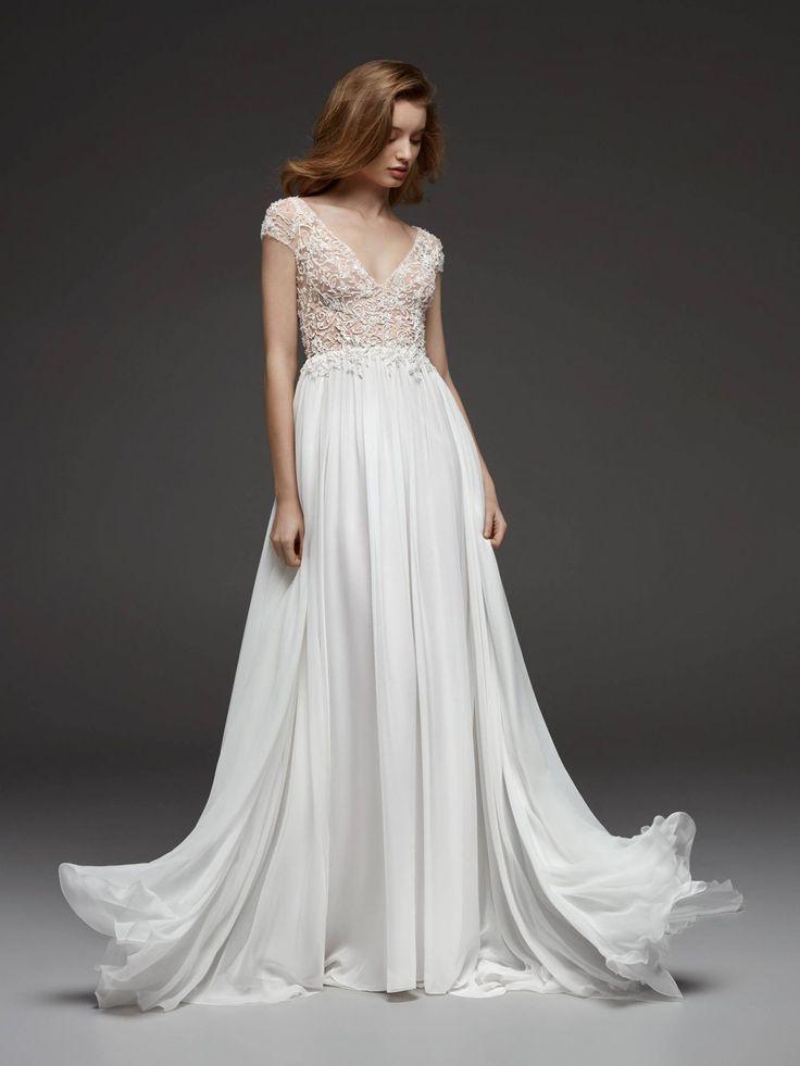 Beaded cap sleeve vneck flowy aline wedding dress