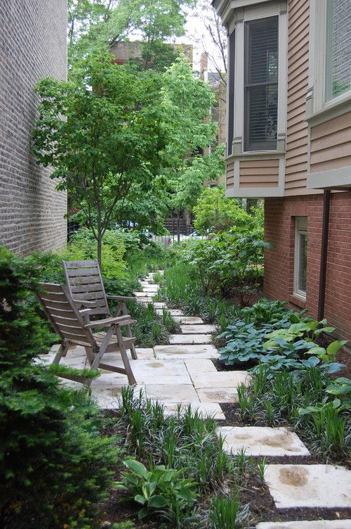 The sliver of land between two homes is easily forgotten, but becomes an outdoor oasis with a little landscaping and a few well-placed chairs. From Houzz - ELLEDecor.com