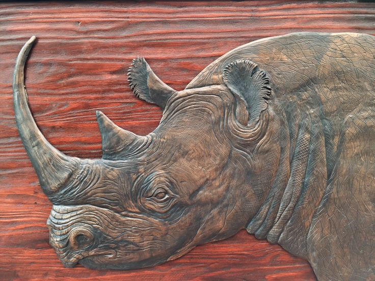 Rhino Head Sculpture. Wall Hanging. Hand Crafted. Wooden Frame: 1140x790mm Rhino Head M1 sculpture casting agent and stained wood. www.Goodieshub.com
