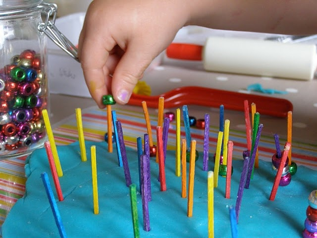 did it. ammi enjoyed it. i just told her to put the beads on the sticks, but she was counting them out at the same time. maybe i'll have her do them by color some time - beads on sticks in playdough for fine motor skills.