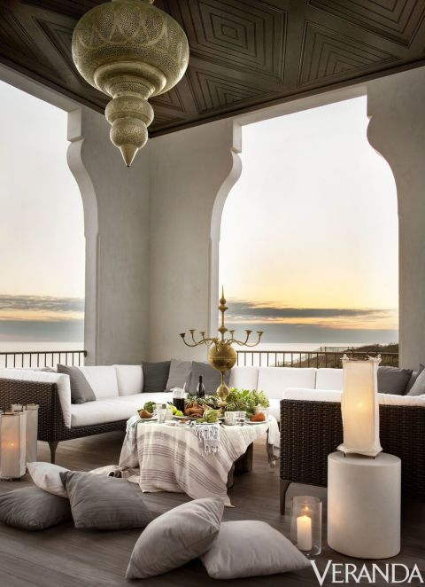 With its bronze lantern and low sectional sofa, the loggia evokes a Moroccan vibe. Sofa, Dedon; side table, Kolo Collection; canvas-covered lanterns, Casamidy.