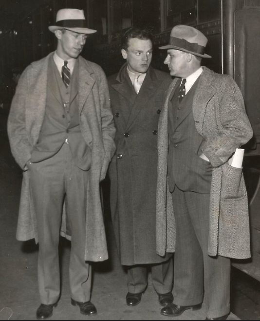 James Cagney, train station in March, 1932. The two men are likely racer Milton Jones (r) and his son, Milton Jones, Jr. If the IDs are correct, possibly a publicity shot related to The Crowd Roars, which would be released in April. Jones died that May following a crash during an Indy 500 warmup.