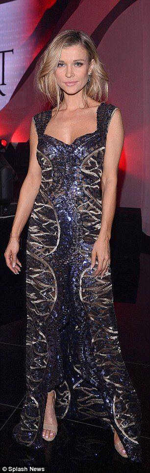 Glamorous: Joanna wowed in the skintight frock, which featured a slit in the middle and sheer elements throughout