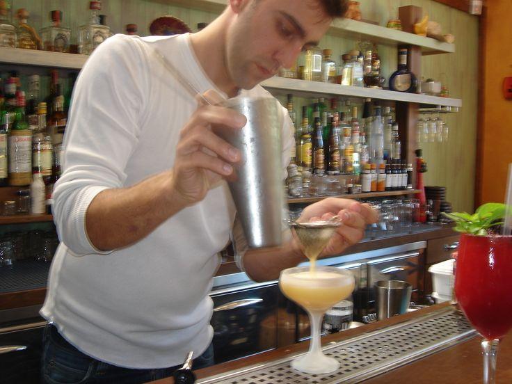Bartender serving cocktail with fruit puree La Fruitiere du Val Evel