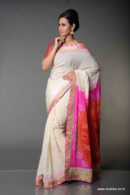 Chandini Milky White Koiri patterned Pure Bandhej Saree; Milky white self coloured koiri patterned delectable saree with a splash of vibrant pink bandhej print pallu, Chakori Milky White Koiri patterned Bandhej saree is a treat to the eyes. True of all Jaipuri bandhej sarees online, it is an imprint of pure Bandhej sarees.