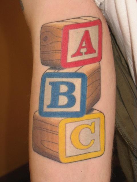 thomas graham super genius tattoo seattle wa color tattoo children 39 s blocks toys tat. Black Bedroom Furniture Sets. Home Design Ideas