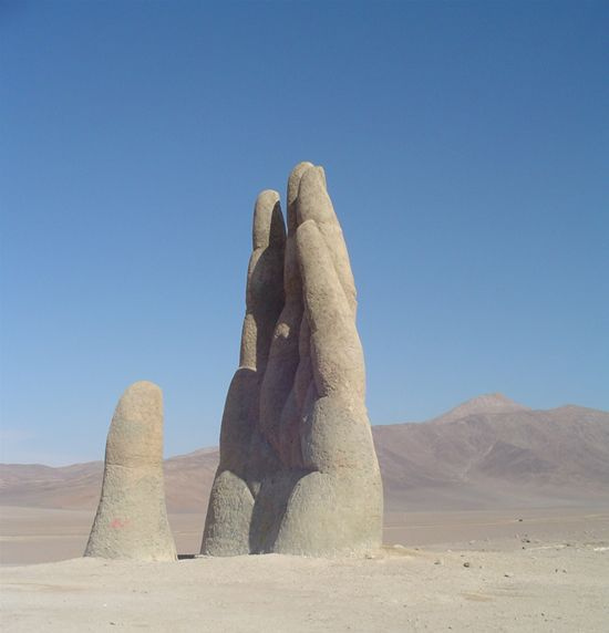 The Hand of the Desert (La Mano del Desierto) is an 11-meters-tall sculpture, in the shape of a hand, rising up from the Atacama Desert, in Chile. by Chilean sculptor Mario Irarrázabal.