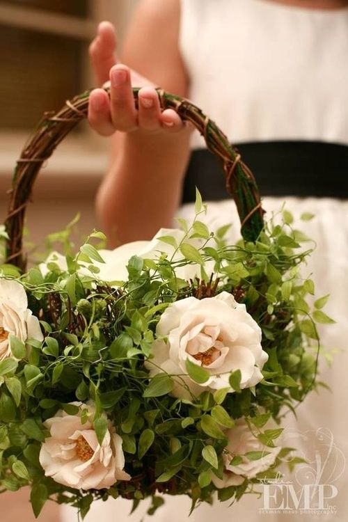 Great flower girl basket!  Decorate the OUTSIDE with greenery and flowers.  Fill the basket with petals for throwing and the basket still looks good during the ceremony and pictures.