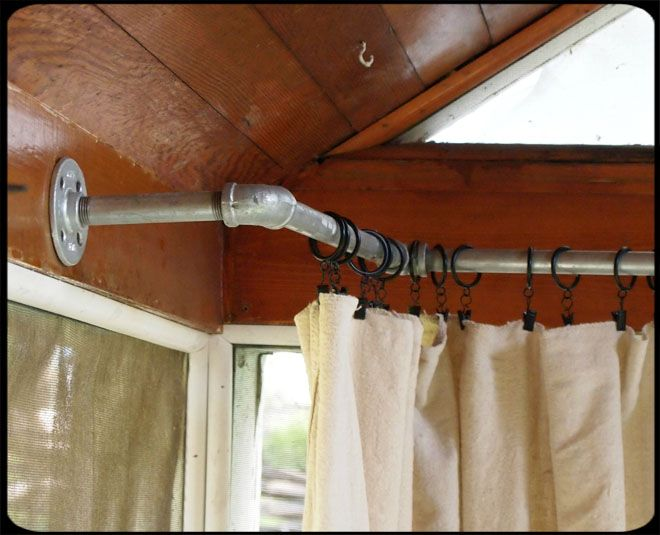 Pipe rod for porch curtains. What a Great Idea!