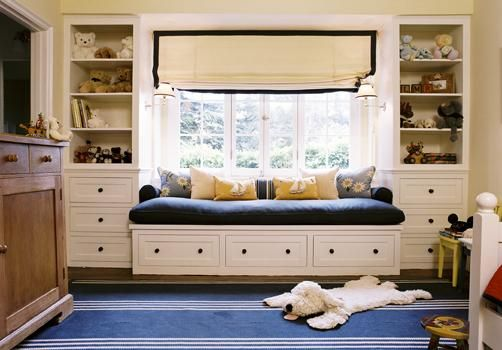 Peter Dunham Design - Boy's blue playroom design with built-in window seat bench shelves ...