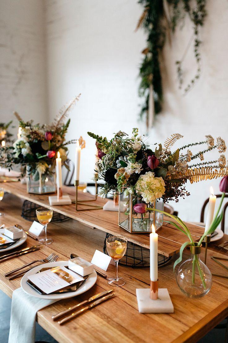 tulip centerpieces - photo by Katie Harmsworth Photography http://ruffledblog.com/mixed-metals-wedding-inspiration