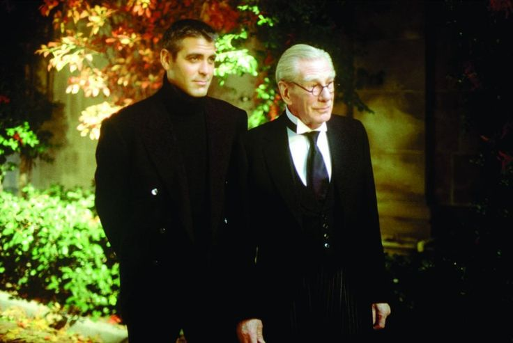 Still of George Clooney and Michael Gough in Batman & Robin (1997)