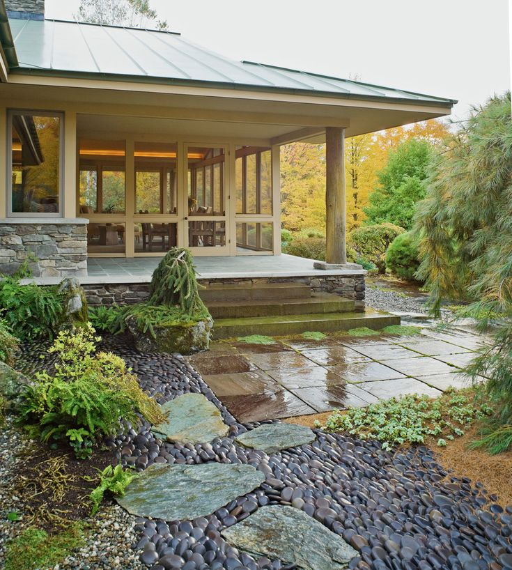 Elegant River Rock home designing tips Asian Landscape Burlington home insurance asian garden back porch decorative pebble ferns flagstone pavers garden path japanese garden Large Eaves overhanging eaves pebble path porch steps prairie style house SCREEN PORCH shade tolerant plants stepping stones vertical metal roof weeping pine tree wood post - Decorcology.com