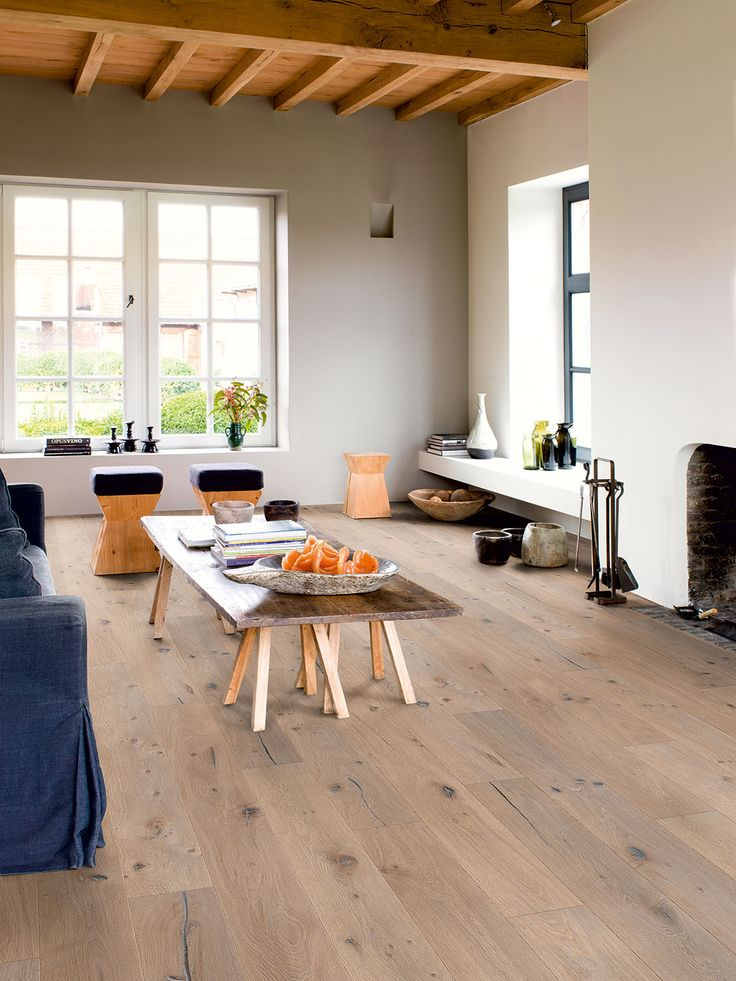 Quick-Step Hardwood Flooring - Imperio 'Nougat oak oiled' (IMP1626) in a country living room. To find more living room inspiration, visit our website: https://www.quick-step.co.uk/en-gb/room-types/choose-the-perfect-living-room-flooring #salon #woonkamer