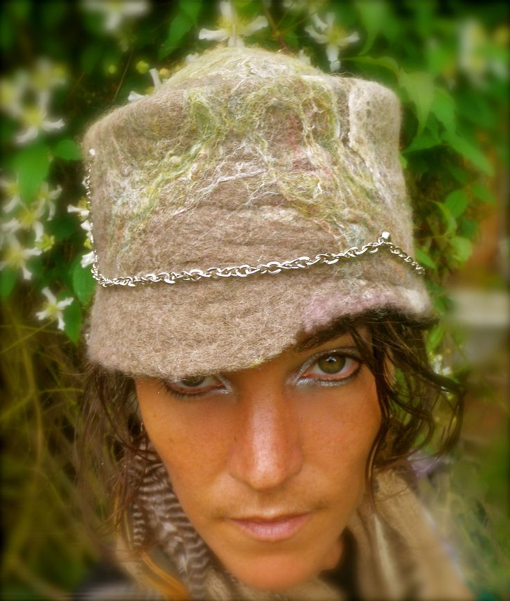 Merino wool and tussah silk handmade wet felted hat with silver chain.