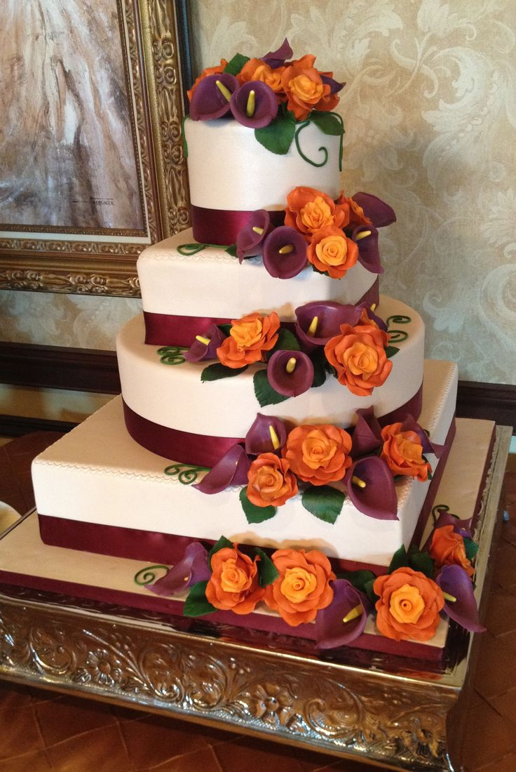 Plum & Burnt Orange Four Tier Fall Wedding - Four tier wedding cake with champagne colored fondant, burnt orange roses and plum calla lilies cascading down the tiers.