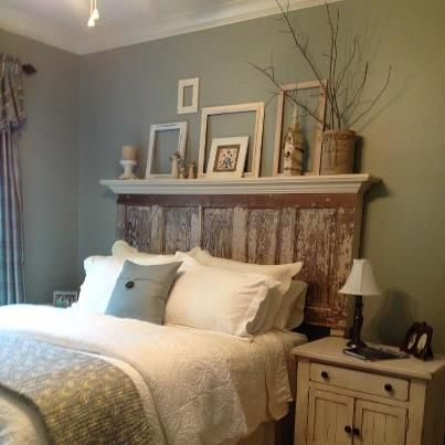 Old Door headboard, love that they put a ledge on the top!