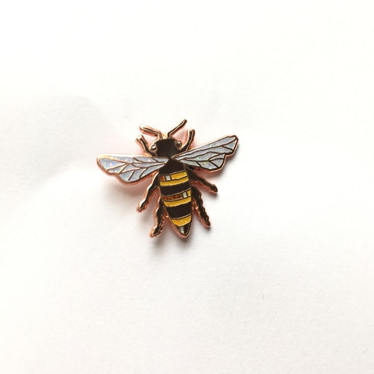 Beautifully detailed Rose Gold Honey Bee Enamel Pin. Rose Gold enamel pin with glittery wings and stripes, this is a cute little buzzy bee that won...