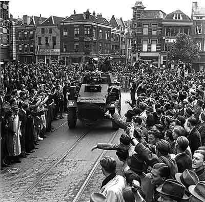 In April, Canadian troops liberated most of the Netherlands. By the time German forces on the British and Canadian front surrendered on 5 May the Canadians had advanced to Oldenburg, in northern Germany, while Canadian paratroopers had penetrated even farther east. The Germans formally surrendered on 8 May 1945, known as Victory-in-Europe, or 'V-E' Day.