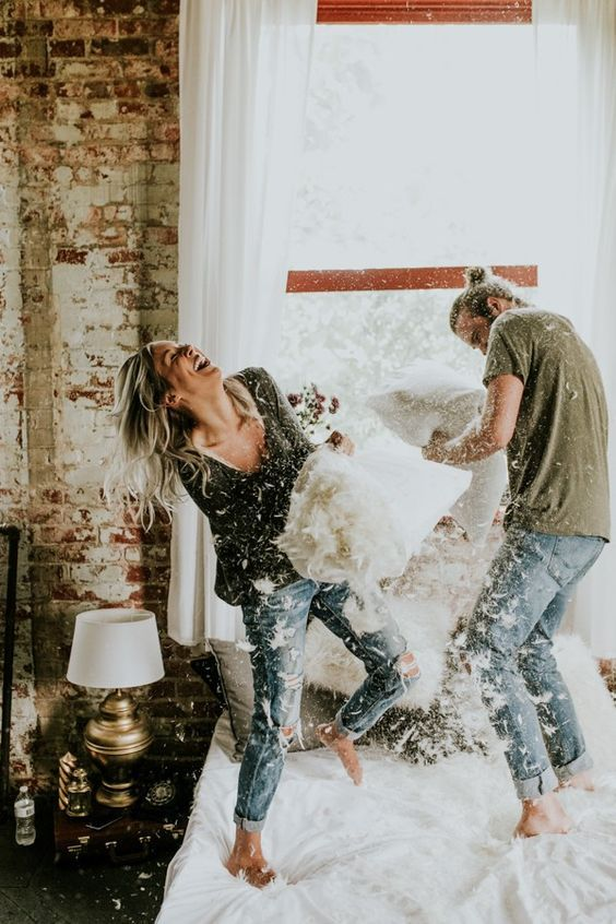 Adorable engagement photos that don't even require leaving the bedroom | Image by Vic Bonvinci Photography
