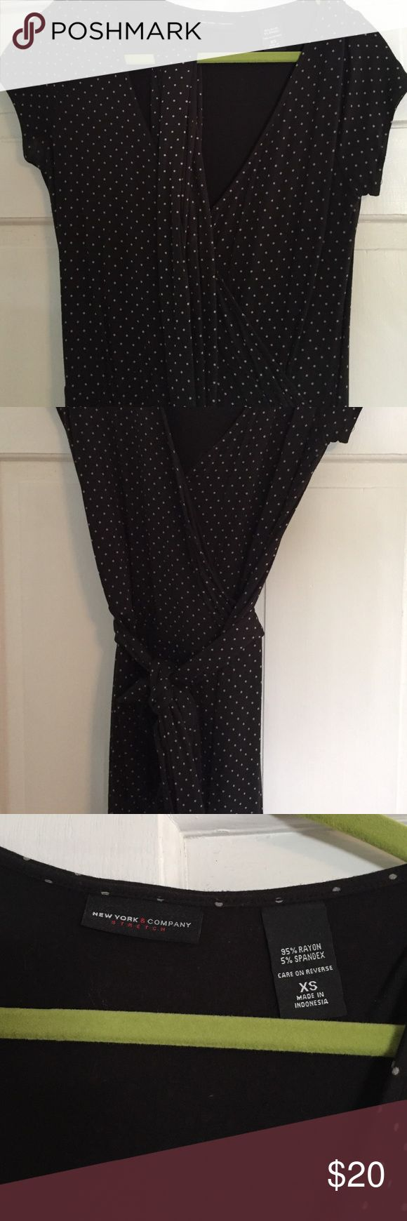"""Black dress Black with small polka dot dress. Perfect for work or a night out. Dress is an X small. However, I am 5""""8 and this fit me at the knees. New York & Company Dresses Midi"""