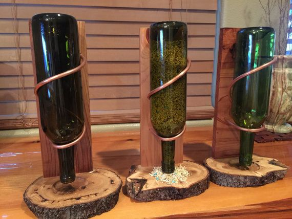 This is a one of a kind bird feeder! This is handmade! The base is made out of Black Oak! Natural log cut, with bark all still in tact around