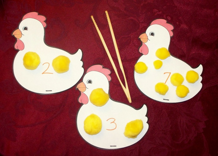 Help the lost chicks get back to their mommy...uses fine motor skills (tonging), recognizing numbers, and counting. :)    The chicken was copied from a Preschool Mailbox magazine, yellow puffballs are from Oriental Trading, toast tongs are from Pampered Chef. ;)