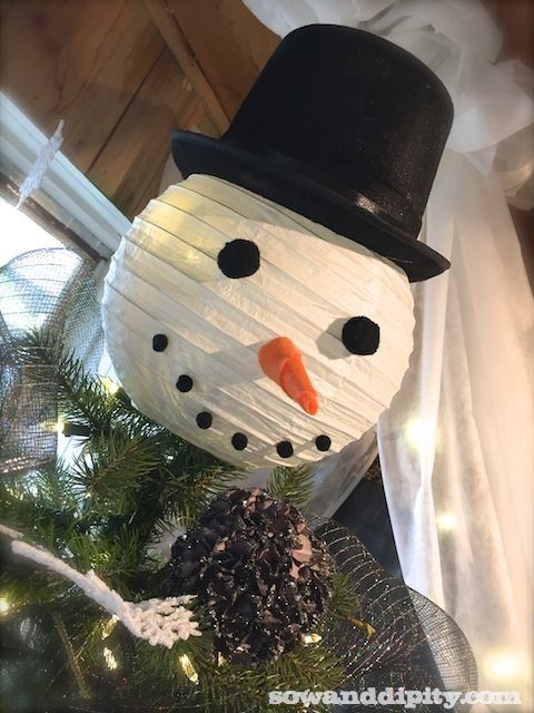 Unusual props for creative Christmas trees! Use a paper lantern for a snowman head topper. See the post for more cool ideas