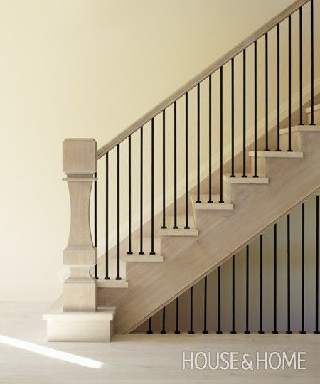A standard handrail & balusters paired with a custom-made newel post.