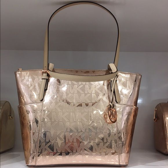 "MICHAEL KORS  Brand new rose gold Michael Kors handbag still in plastic with tags attached. Absolutely gorgeous!!! will ship with Michael Kors shopping bag  Pictures are of floor model. The one you will purchase has never been opened ( only to remove security alarm) Measurements: 16"" W x 11"" H x 4.5"" D Michael Kors Bags Totes"