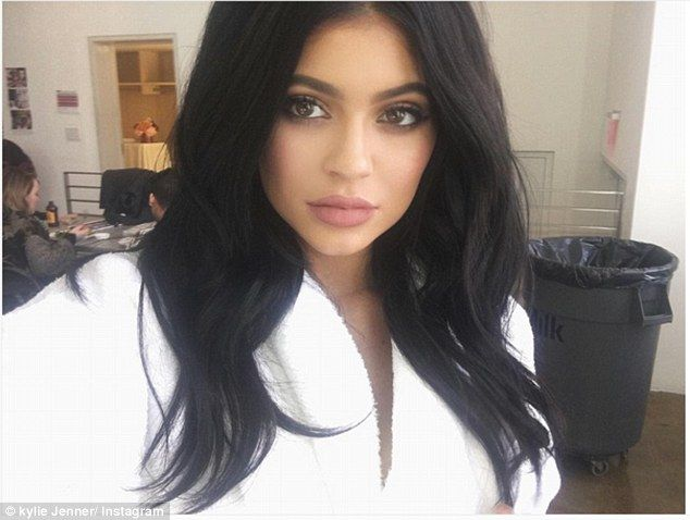 Scarred for life: 18-year-old Kylie Jenner displayed her battle wound on Wednesday, a mark she earned during an innocent game of hide and seek with sister Kendall, 20. She shared this selfie along with her leg picture, simply captioning it with a lip emoji