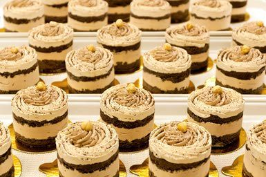 Gourmet multilayer chocolate cakes decorated with hazel nuts - Travelif/Photodisc/Getty Images